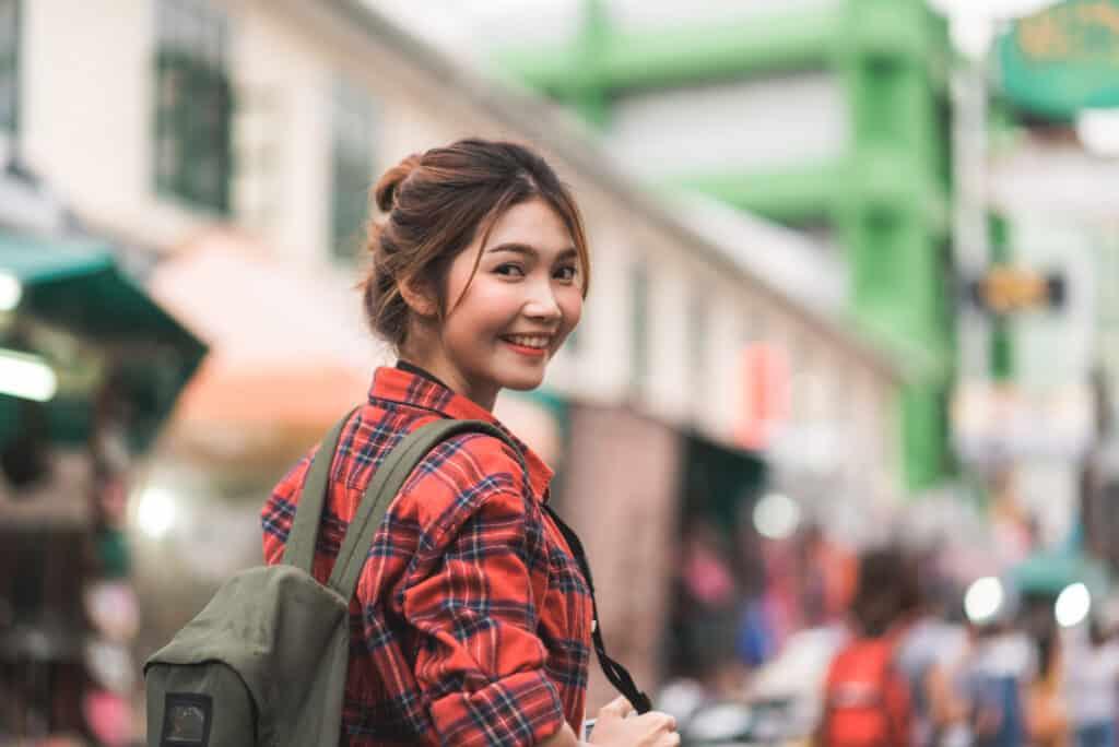 traveler backpacker asian woman travel khao san road bangkok thailand